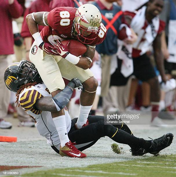 Florida State wide receiver Rashad Greene is pulled out of bounds after a catch against BethuneCookman at Doak Campbell Stadium in Tallahassee...