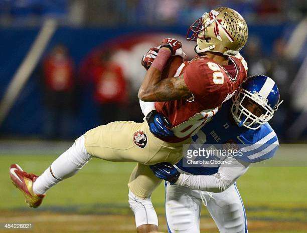 Florida State wide receiver Rashad Greene is tackled by Duke cornerback DeVon Edwards following a pass reception in the second quarter in the ACC...