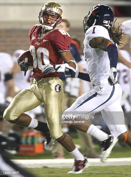 Florida State wide receiver Rashad Greene outruns Virginia cornerback Demetrious Nicholson at Doak Campbell Stadium in Tallahassee Florida on...