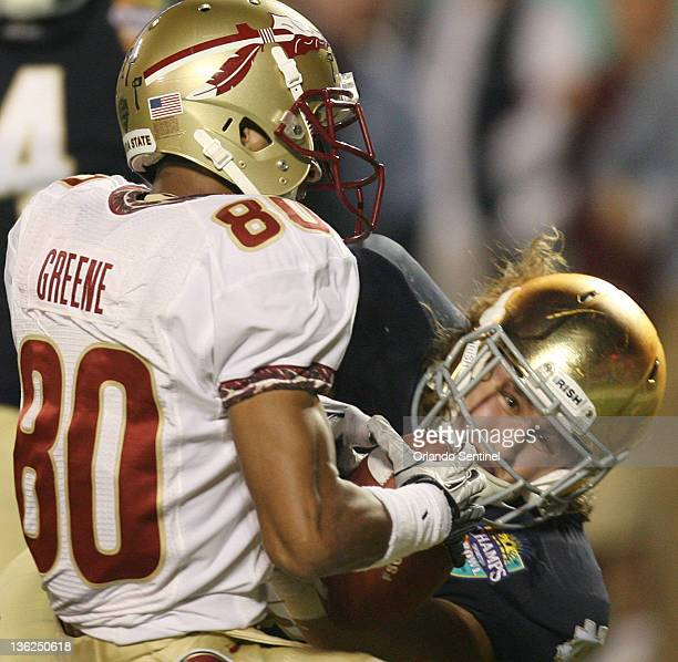 Florida State wide receiver Rashad Greene pulls in the winning touchdown against Notre Dame linebacker Dan Fox during the Champs Sports Bowl at the...