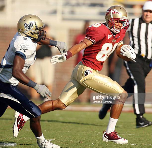Florida State wide receiver Rashad Greene right brushes aside Charleston defensive back O'Brian Campbell left during game action at Doak Campbell...