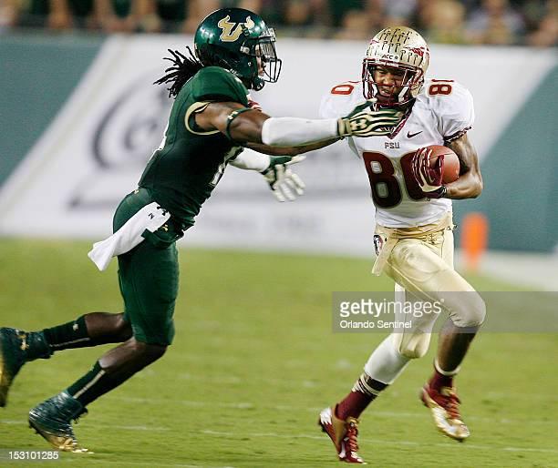 Florida State wide receiver Rashad Greene runs away from South Florida cornerback Fidel Montgomery at Raymond James Stadium in Tampa Florida on...