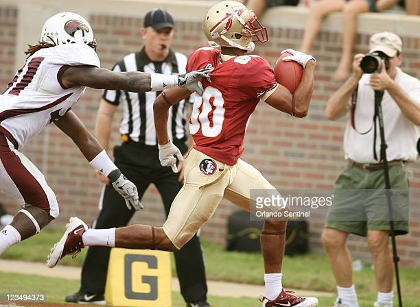 Florida State wide receiver Rashad Greene runs for the end zone for a touchdown against the University of LouisianaMonroe at Doak Campbell Stadium in...