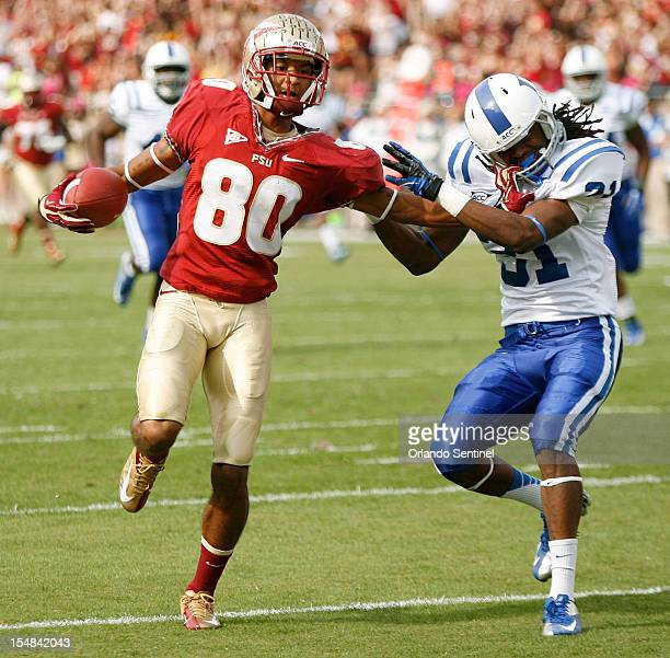 Florida State wide receiver Rashad Greene shrugs off Duke cornerback Tony Foster en route to a 71yard touchdown reception at Doak Campbell Stadium in...