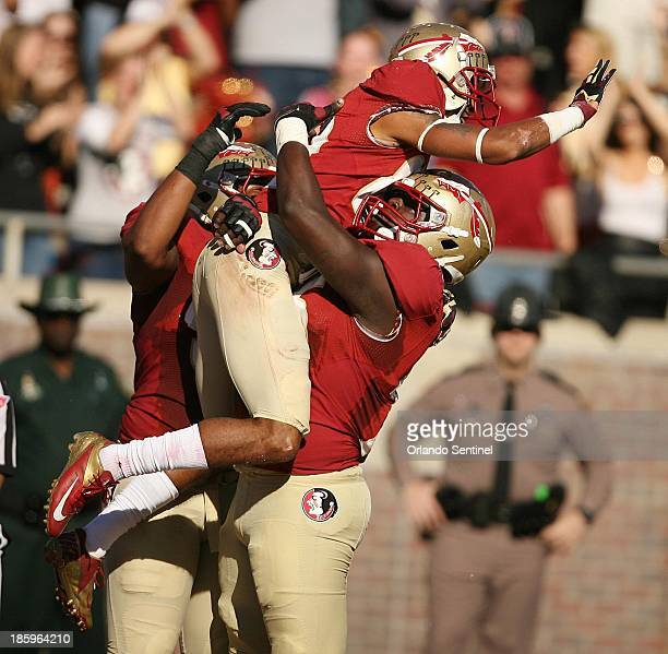 Florida State wide receiver Rashad Greene top celebrates after a 42yard firstquarter touchdown catch against North Carolina State at Doak Campbell...