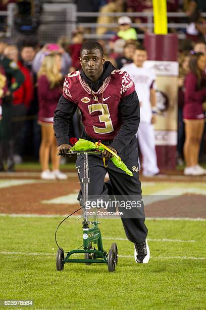 Florida State WR Jesus Bobo Wilson takes the field on his scooter after injuring his knee earlier in the season on senior night before the NCAA...