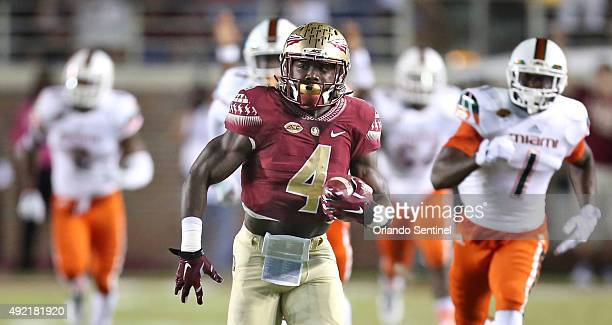 Florida State's Dalvin Cook scores on a 36yard touchdown pass and a 72yard run in the first quarter against Miami at Doak Campbell Stadium in...