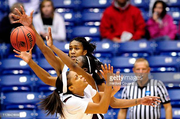 Florida State's Jacinta Monroe back and Courtney Ward front sandwich Mississippi State's Alexis Rack during the women's NCAA Basketball Tournament in...