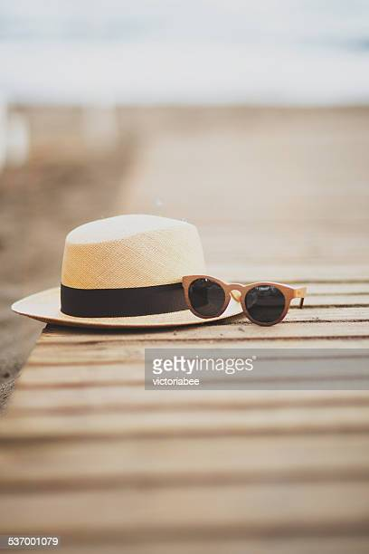 usa, florida, straw hat and sunglasses on beach - straw hat stock pictures, royalty-free photos & images