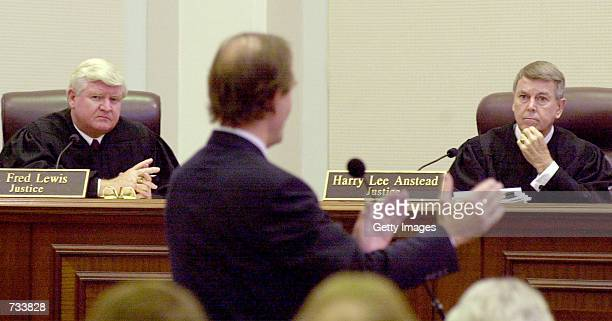Florida Supreme Court Justices R. Fred Lewis, left, and Harry Lee Anstead listen as Gore's attorney David Boies speaks during a hearing at the...