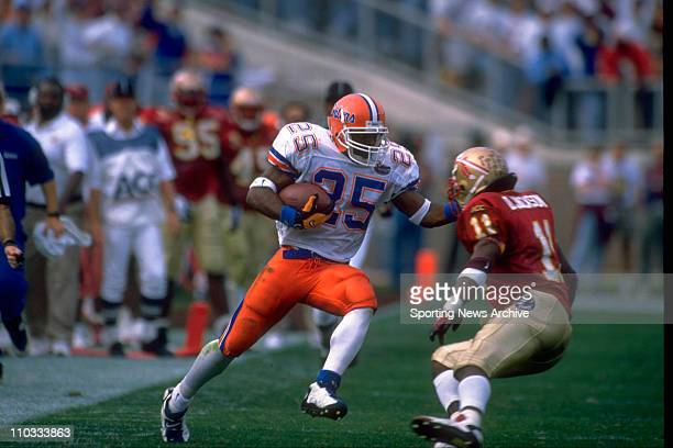 Florida tailback Elijah Williams carrying the ball and putting a move on Florida State safety Dexter Jackson during a game on November 30 1996 in...