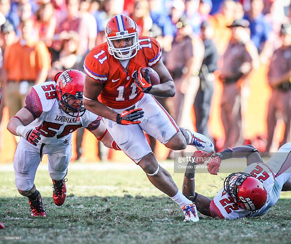 Florida tight end Jordan Reed (11) evades a tackle by Louisiana-Lafayette's Melvin White (22) as he runs for yardage during fourth-quarter action at Ben Hill Griffin Stadium on Saturday, November 10, 2012, in Gainesville, Florida. The host Gators rallied for a 27-20 win.