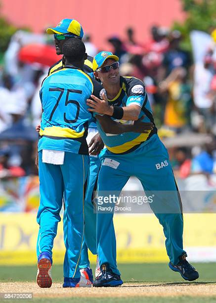 Florida United States 30 July 2016 Michael Hussey and Jerome Taylor of St Lucia Zouks celebrate the dismissal of Alex Ross of Jamaica Tallawah during...