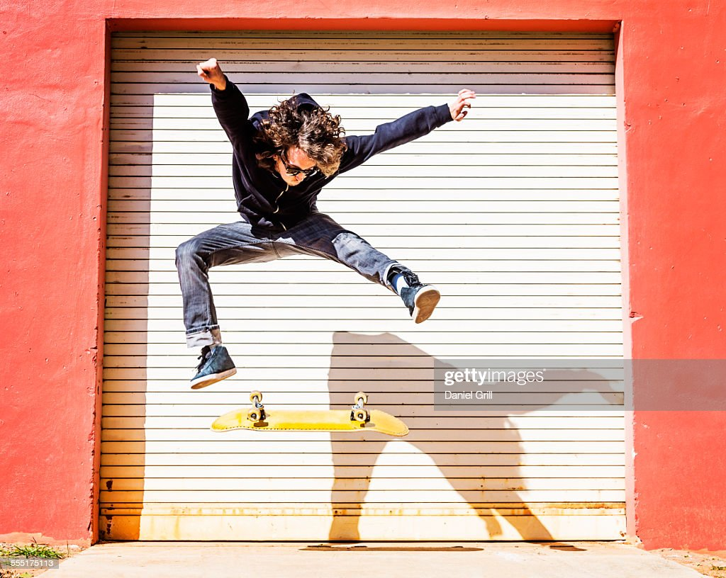 Usa Florida West Palm Beach Man Jumping On Skateboard Against Closed