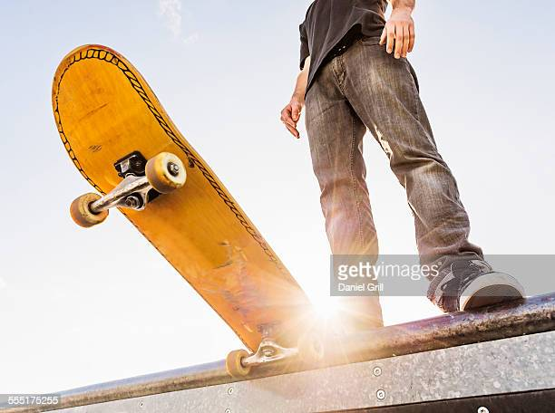 USA, Florida, West Palm Beach, Man with skateboard at the edge of ramp