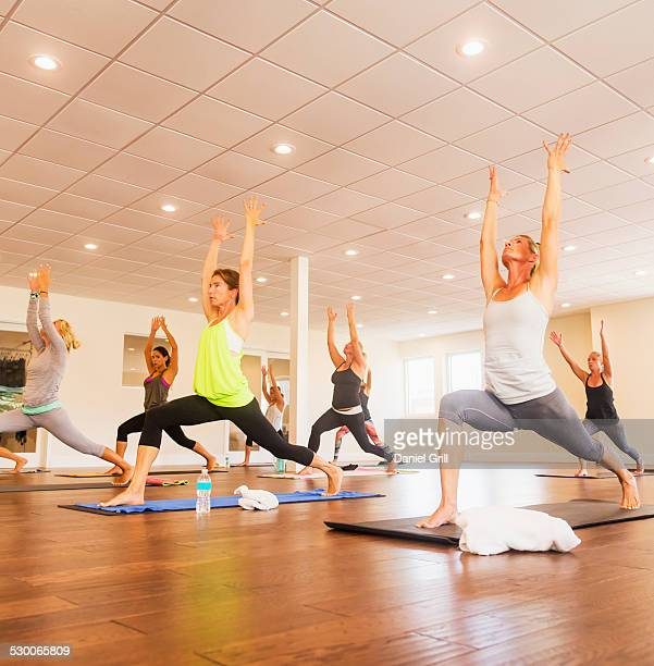 USA, Florida, West Palm Beach, Women exercising yoga