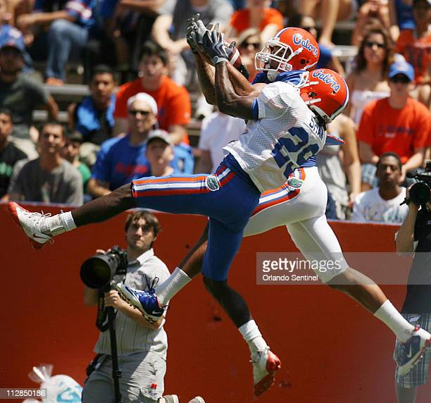 Florida wide receiver Carl Moore and cornerback Joshua Shaw battle for a pass during the Orange Blue football game at Florida Field on the campus of...