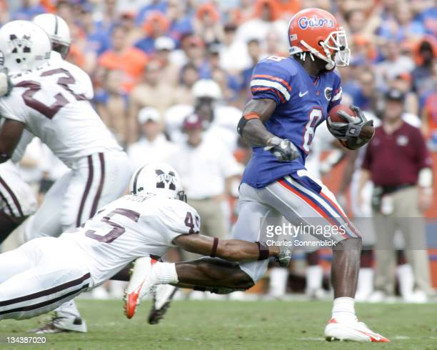 Florida wide receiver Chad Jackson catches a pass and avoids Mississippi State defensive back De'Mon Glanton on October 8, 2005 at Ben Hill Griffin...