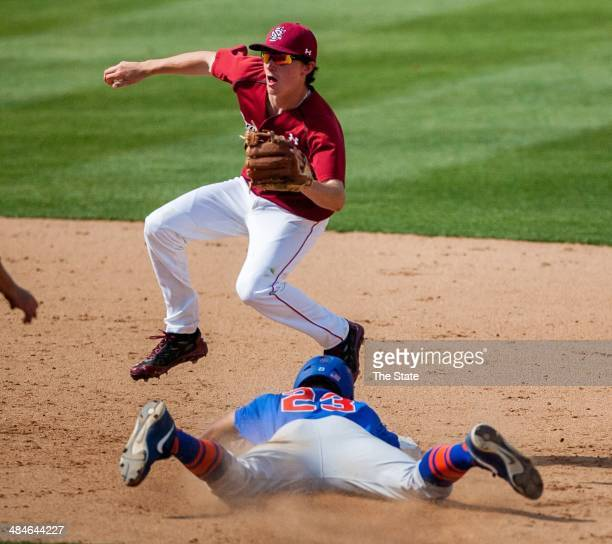 Florida's Buddy Reed advances to second base after no one covered as South Carolina's Jordan Gore takes the throw in the eight inning in Columbia SC...