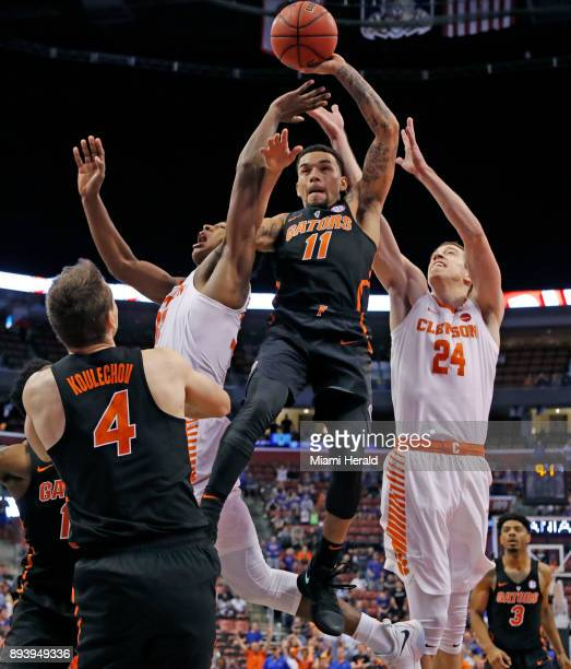 Florida's Chris Chiozza takes a rebound in the second half against Clemson during the Orange Bowl Basketball Classic at the BBT Center in Sunrise Fla...