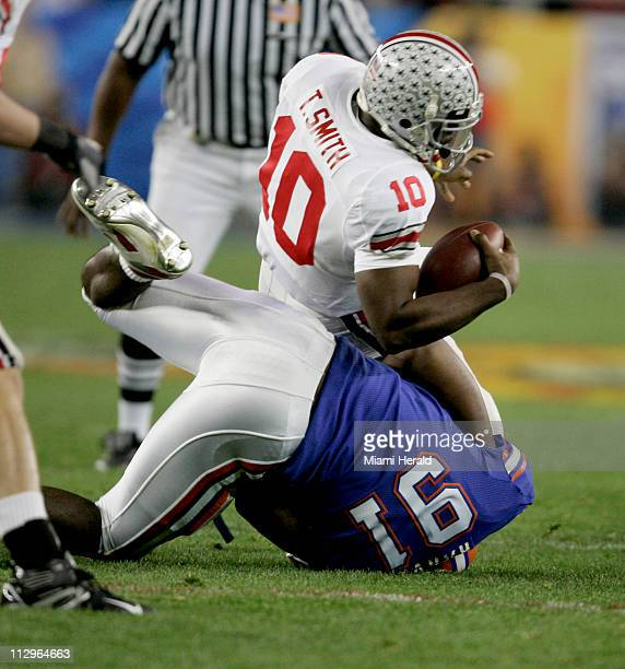 Florida's Derrick Harvey sacks Ohio State quarterback Troy Smith in the first quarter during the BCS national championship game in Glendale Arizona...