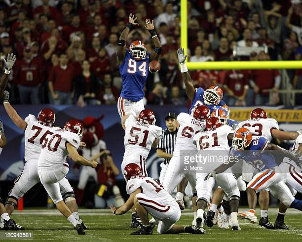 Florida's Jarvis Moss looks to block this Arkansas field goal attempt during Saturday's SEC Championship Game at the Georgia Dome in Atlanta Georgia...