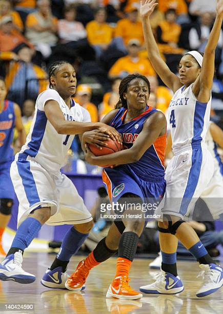 Florida's Jaterra Bonds center managed to get rid of the ball and avoided a tieup call while being pressured by Kentucky's A'dia Mathies left and...