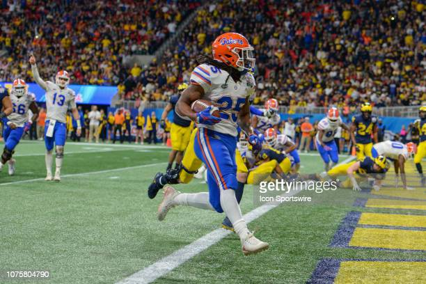 Florida's Jordan Scarlett scores s touchdown during the second half of the ChickfilA Peach Bowl between the Michigan Wolverines and the Florida...