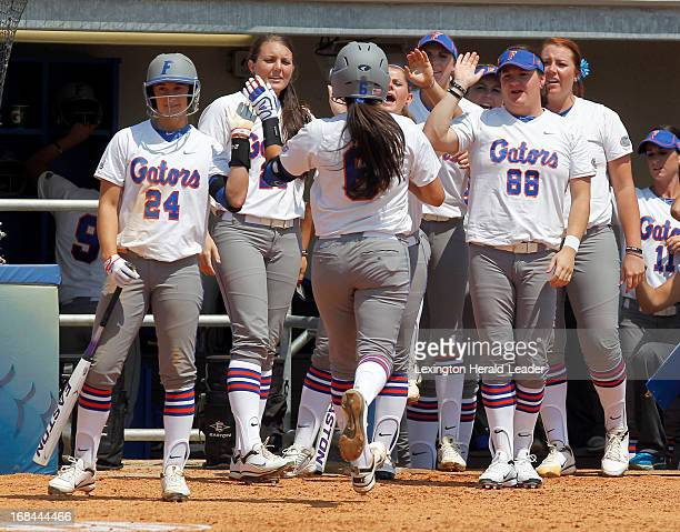 Florida's Katie Medina is congratulated after a successful sacrifice bunt in the bottom of the 4th inning against Alabama in the SEC Softball...