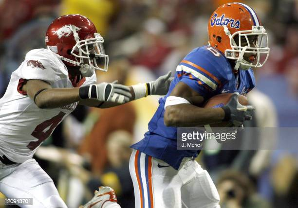 Florida's Percy Harvin is on the receiving end of a Chris Leak pass as Arkansas corner Darius Vinnett is late on the coverage during Saturday's SEC...