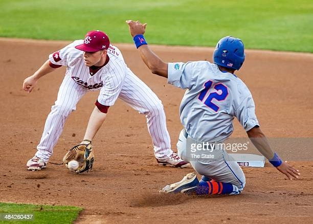Florida's Richie Martin steals second base as South Carolina Gamecocks second baseman DC Arendas takes the throw in the first inning at Carolina...