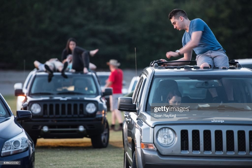 Floridians Craig Wicks, right, and Rebecca Richardson prepare for a drive-in movie at the Historic Columbia Speedway August 20, 2017 in Columbia, South Carolina. Columbia is one of the prime destinations for viewing Monday's solar eclipse, and NASA expects clear weather to bring over a million visitors to the state.