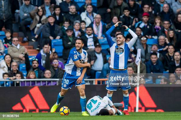 Florin Andone and Lucas Perez Martinez of RC Deportivo La Coruna reacts as Carlos Henrique Casemiro of Real Madrid lies on the pitch during the La...