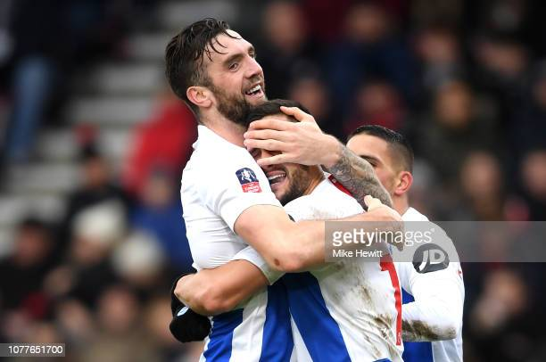 Florin Andone of Brighton and Hove Albion celebrates after scoring his team's third goal with Shane Duffy during the FA Cup Third Round match between...