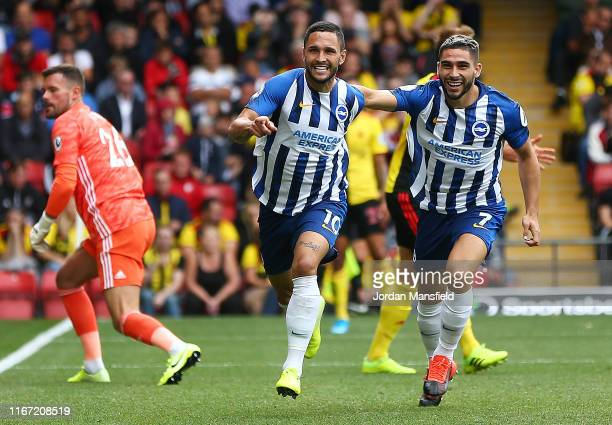 Florin Andone of Brighton and Hove Albion celebrates with teammate Neal Maupay after scoring his team's second goal during the Premier League match...