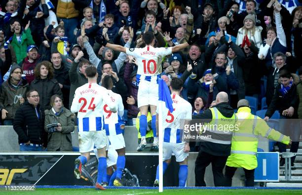 Florin Andone of Brighton and Hove Albion celebrates with teammates after scoring his team's first goal during the Premier League match between...