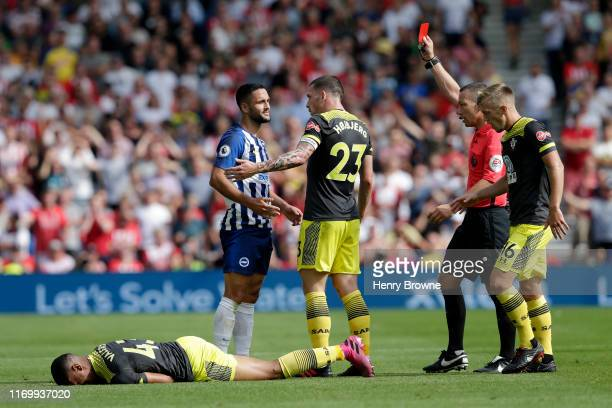 Florin Andone of Brighton and Hove Albion is shown a red card by referee Kevin Friend during the Premier League match between Brighton & Hove Albion...
