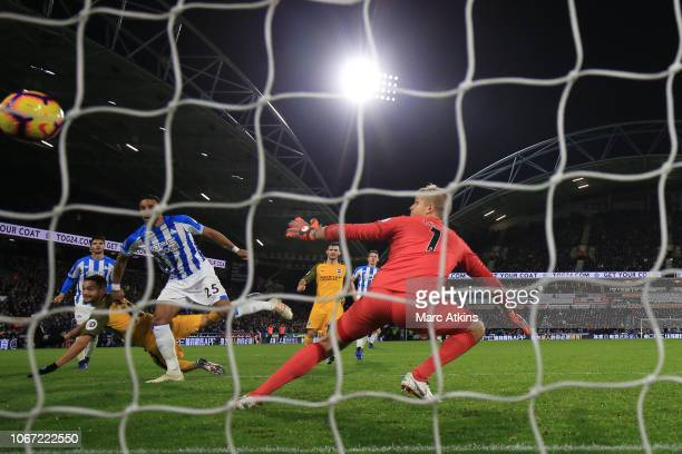 Florin Andone of Brighton and Hove Albion scores their 2nd goal during the Premier League match between Huddersfield Town and Brighton & Hove Albion...