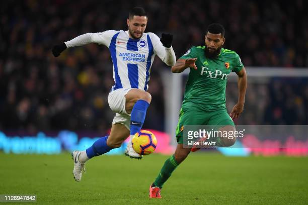 Florin Andone of Brighton Hove Albion gets away from Adrian Mariappa of Watford during the Premier League match between Brighton Hove Albion and...