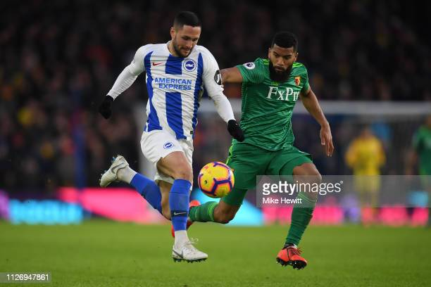 Florin Andone of Brighton & Hove Albion gets away from Adrian Mariappa of Watford during the Premier League match between Brighton & Hove Albion and...
