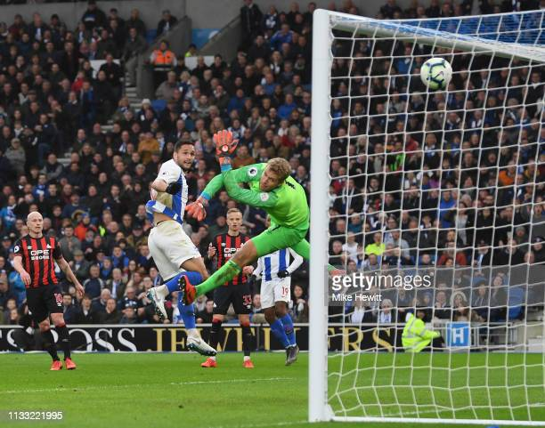 Florin Andone of Brighton & Hove Albion heads past Jonas Lossl of Huddersfield Town for the only goal of the game during the Premier League match...