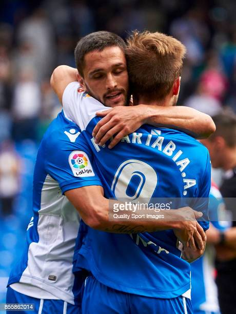Florin Andone of Deportivo de La Coruna celebrate the victory with Fede Cartabria of Deportivo de La Coruna during the La Liga match between...