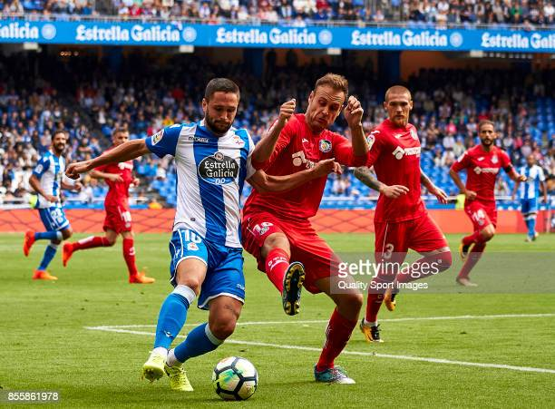 Florin Andone of Deportivo de La Coruna competes for the ball with Juan Cala of Getafe CF during the La Liga match between Deportivo La Coruna and...