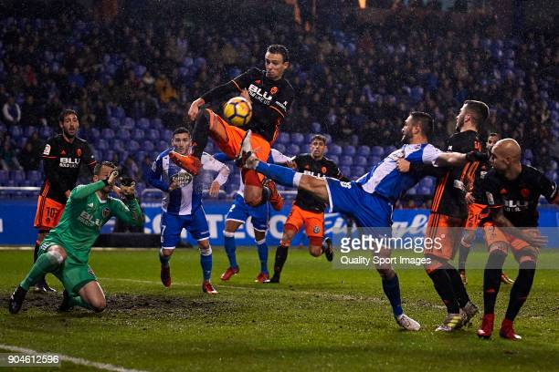 Florin Andone of Deportivo de La Coruna competes for the ball with Nemanja Maksimovic of Valencia CF during the La Liga match between Deportivo La...