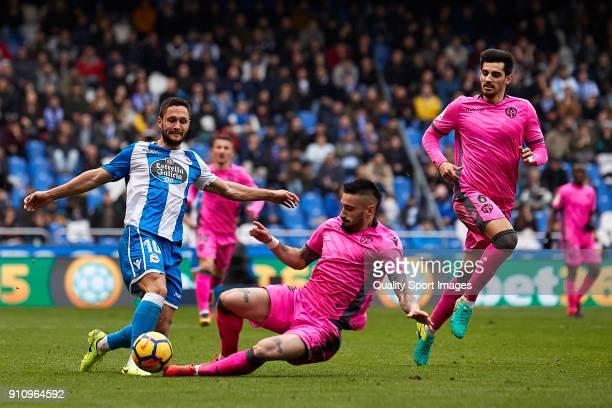 Florin Andone of Deportivo de La Coruna competes for the ball with Erick Cabaco of UD Levante during the La Liga match between Deportivo La Coruna...