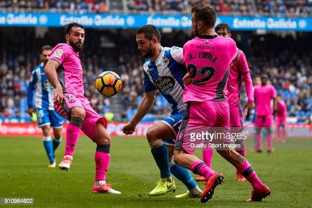 Florin Andone of Deportivo de La Coruna competes for the ball with Antonio Luna of UD Levante during the La Liga match between Deportivo La Coruna...