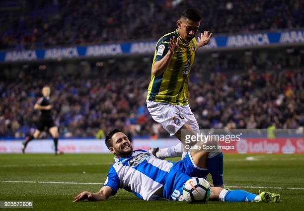 Florin Andone of Deportivo de La Coruna competes for the ball with Oscar Duarte of RCD Espanyol during the La Liga match between Deportivo La Coruna...