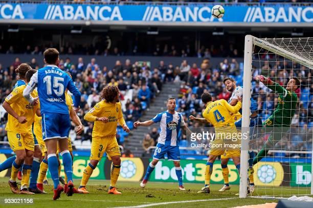 Florin Andone of Deportivo de La Coruna competes for the ball with Leandro Chichizola of UD Las Palmas during the La Liga match between Deportivo La...