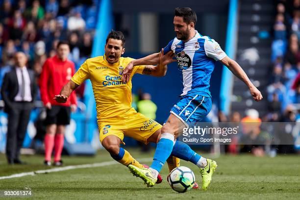 Florin Andone of Deportivo de La Coruna competes for the ball with David Simon of UD Las Palmas during the La Liga match between Deportivo La Coruna...
