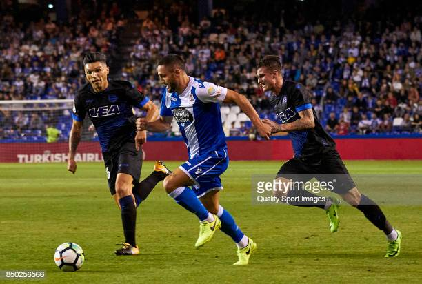 Florin Andone of Deportivo de La Coruna is challenged by Daniel Torres of Deportivo Alaves during the La Liga match between Deportivo La Coruna and...